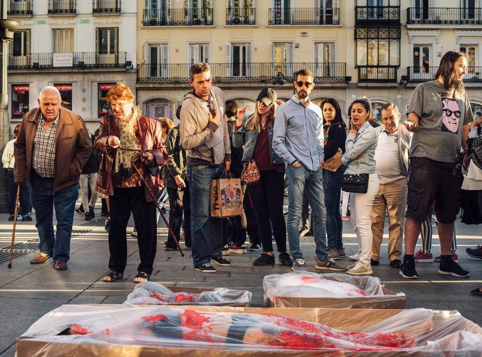 """Activists in the Puerta del Sol in Madrid stage a protest called """"Packaged""""  in"""