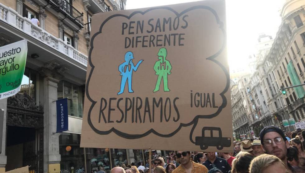 """Protest to protect Madrid Cental on July 6. Sign reads: """"We think differently, we breathe the same."""""""