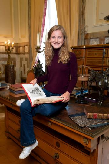 Isabel from Belgium, dressed casually, in one of the official images distributed for her 18th birthday.