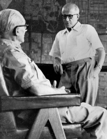 Le Corbusier and Pierre Jeanneret on one of the armchairs that the second designed for Chandigarh. |