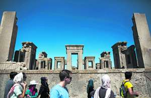 Visitors in the palace of Darius I, in Persepolis (Iran).