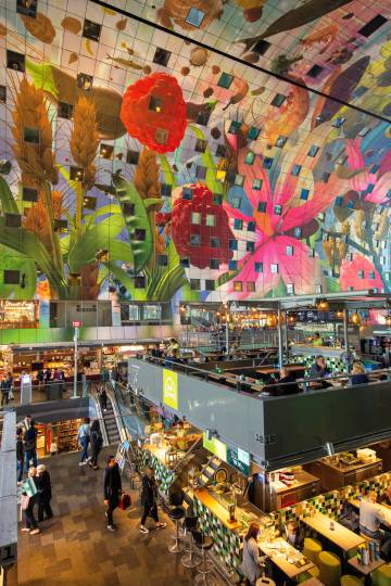 Inside the Markthal, a horseshoe-shaped market that also houses homes and offices in Rotterdam.