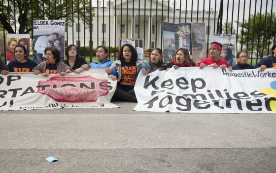 Demonstrators hold a protest in front of the White House against the deportations.