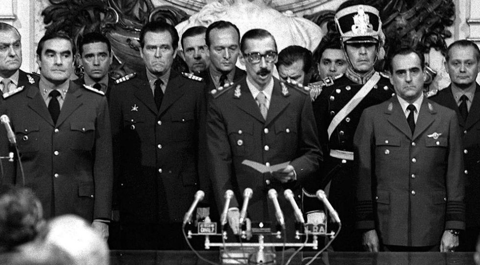 Jorge Rafael Videla (c) is sworn in as president of the military junta in Argentina in 1976.