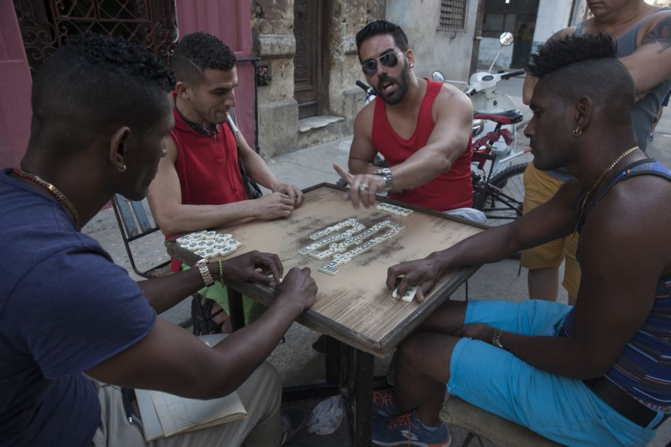 A group of Cubans playing domino on a Havana street.