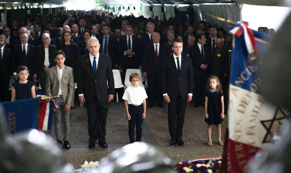 Netanyahu y Macron en la ceremonia de conmemoración de las víctimas del Velódromo de Invierno en París este domingo.rn rn