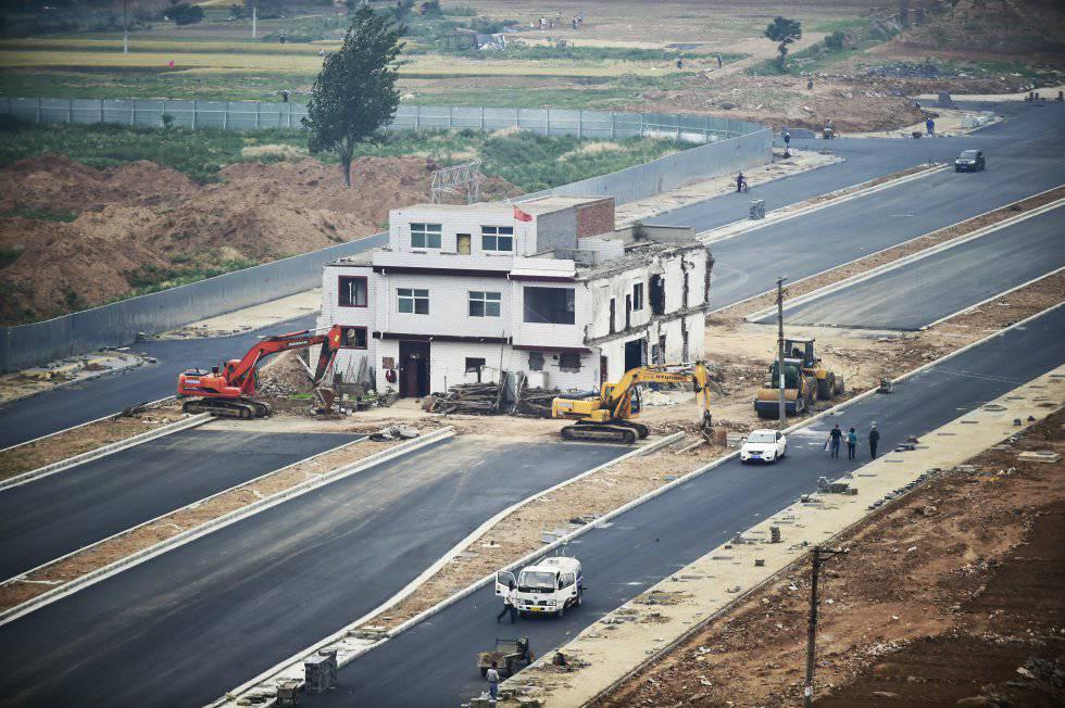 As 'casas prego' da China, ou como resistir a uma demolição durante 14 anos