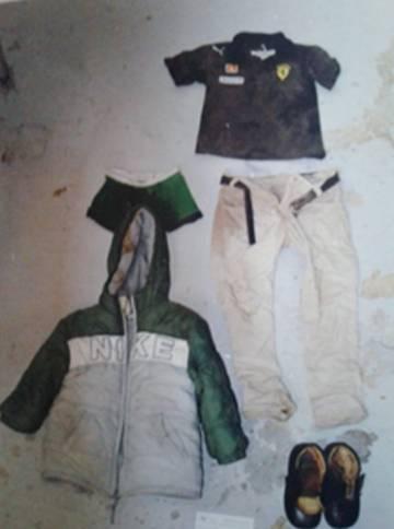 La ropa que vestía el niño asesinado.