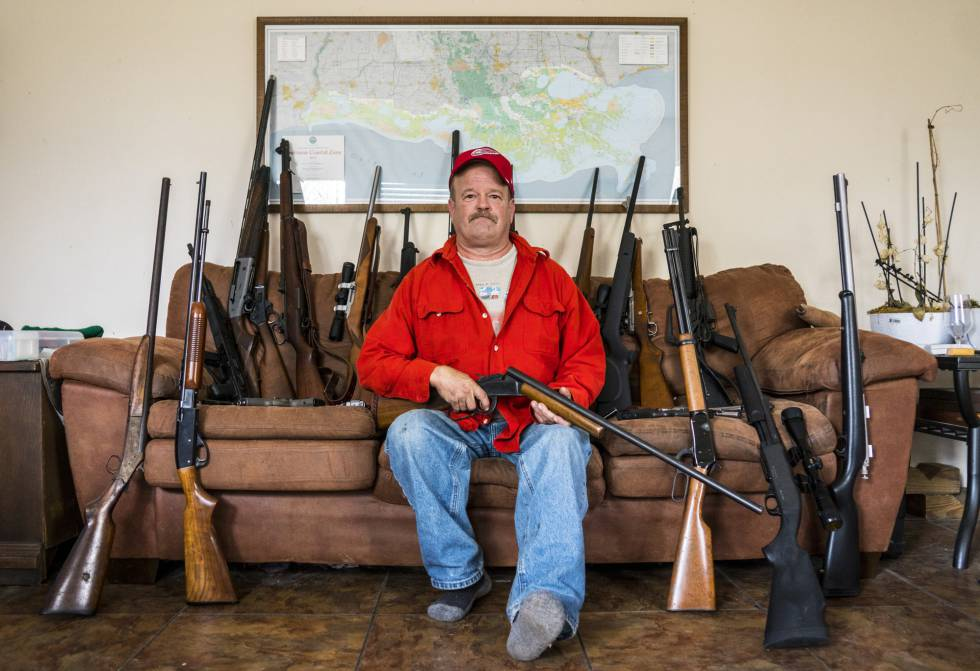 Scott Porter, with his many guns at home in Louisiana.