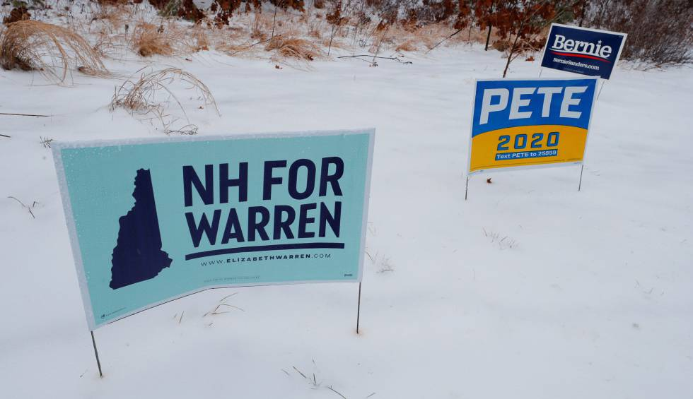 Carteles de Elizabeth Warrem, Pete Buttigieg y Bernie Sanders, en New Hampshire.