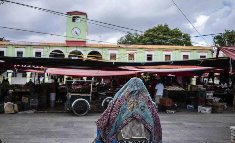 A woman walks in the center of El Espinal, Oaxaca.