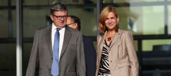 Princess Cristina and her secretary, Carlos García Revenga, after visiting the king in hospital following his recent operation.