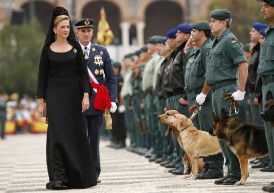 Princess Cristina inspects troops during an official event in Seville in 2008.