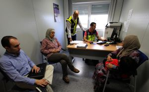 A Syrian woman requests asylum in the Spanish offices at the border of Melilla and Morocco.