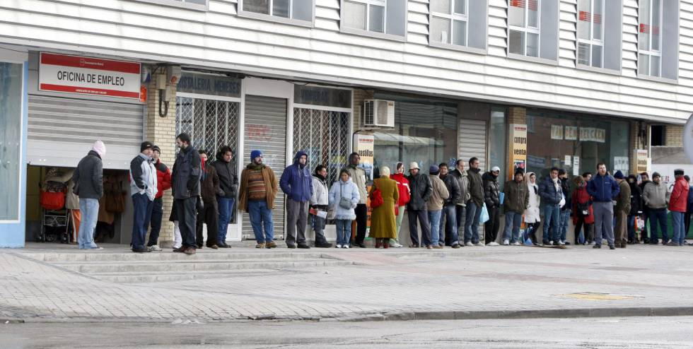 People lining up outside an employment office.
