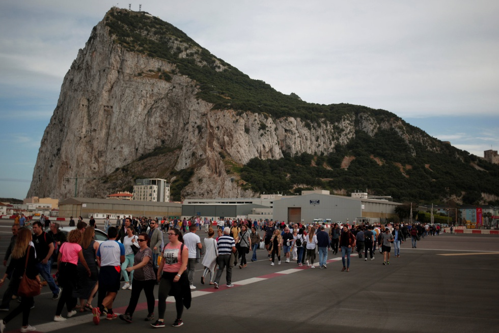 Pedestrians cross the runway at Gibraltar airport.