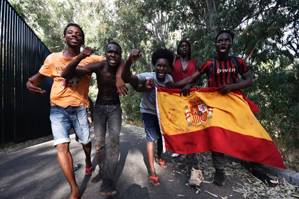 migrant crisis in europe more than 100 migrants manage to jump