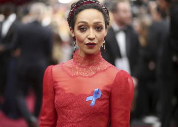 Ruth Negga, wearing the ACLU ribbon, arrives at the Oscars on Sunday, Feb. 26, 2017, at the Dolby Theatre in Los Angeles. (Photo by Matt SaylesInvisionAP)
