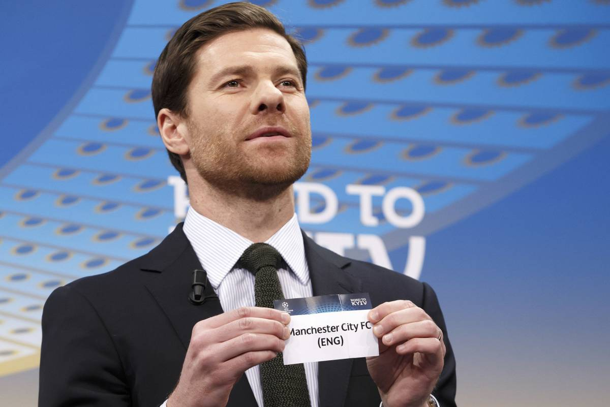 Former Spanish player Xabi Alonso holds the ticket of Manchester City during the drawing of the games for the Champions League 201718 Round of 16, at the UEFA headquarters, in Nyon, Switzerland, Monday, Dec. 11, 2017. (Salvatore Di NolfiKeystone via AP)