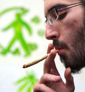 A man smoking cannabis at a Barcelona club.