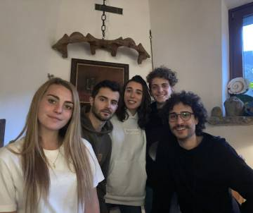Adrián Fernández, second from the left, in the country house where he has taken refuge.
