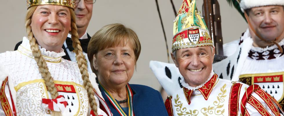 Angela Merkel (de azul).